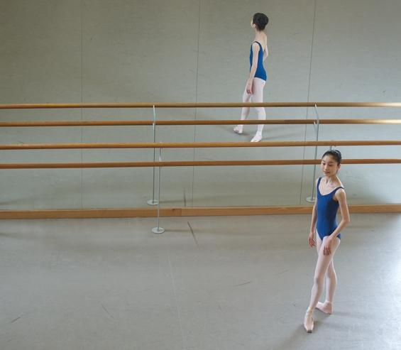 A student in a ballet studio, at Elmhurst School for Dance.
