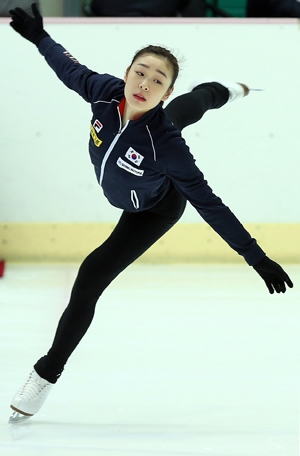 Figure skater Kim Yuna trains at the Korean National Training Center, Seoul, in preparation for the 2014 Sochi Winter Olympics.