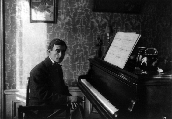 Maurice Ravel at his piano