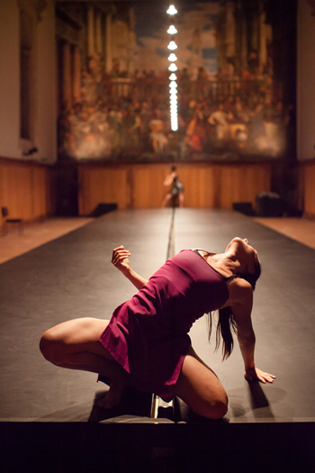 Avatâra Ayuso, with Sunbee Han in the background, in Shobana Jeyasingh's Outlander at the Venice Dance Biennale.